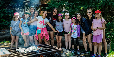 girls standing in fron of fire pit