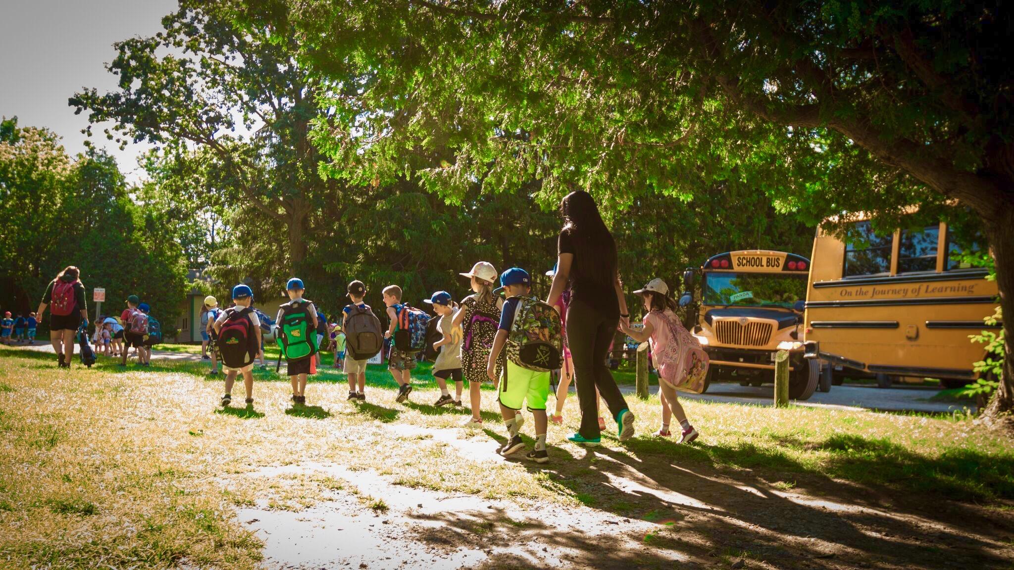 children walking to camp